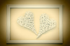 Two vintage hearts in frame Stock Photography