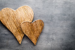 Two vintage hearts on gray metal background. Royalty Free Stock Image