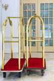 Two vintage hotel baggage carts Stock Images