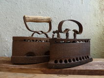 Two vintage iron on a wooden board Royalty Free Stock Photos