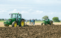 Two vintage John Deere tractor pulling a plough Royalty Free Stock Photo