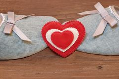 Two Vintage Kissing Slippers and Red White Heart Royalty Free Stock Image