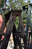 Two vintage ladders. Two vintage industrial ladders outdoors royalty free stock photo