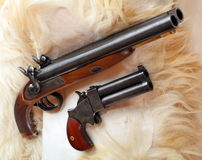 Two vintage large-bore pistols. Royalty Free Stock Photography