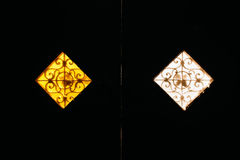 Two vintage matte windows of yellow and white royalty free stock images