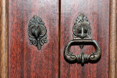 Two vintage metal handles. Two old vintage metal handles of a wooden closet, one intact and the other one broken royalty free stock images