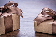 Two vintage pepr giftboxes with brown bows on old Stock Photo