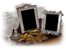 Two Vintage Photo Frames. Two vintage silver photo frames and old glasses, surrounded with a white vignette Royalty Free Stock Image