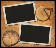 Two Vintage Photo Frames on Wood Wall Royalty Free Stock Image