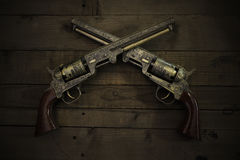 Two vintage pistols on wooden background Stock Photo