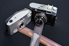 Two vintage rangefinder camera and rolls of film. Two vintage rangefinder camera and rolls of photographic film Stock Photography