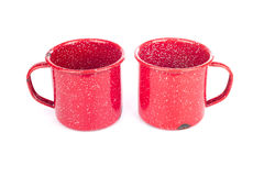 Two vintage red metal cups Stock Photos