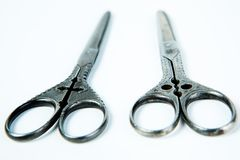 Two vintage scissors with ornament on handle - decoration royalty free stock photo