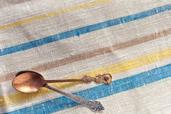Two vintage spoons. On linen fabric Stock Images
