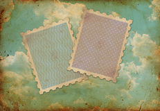 Two vintage stamps. On old photo of sky Stock Photography