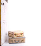 Two vintage suitcases. Stacked by a vintage or antique door Royalty Free Stock Images