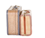 Two vintage suitcases isolated. Two vintage suitcases closed on their sides isolated on white Royalty Free Stock Photos