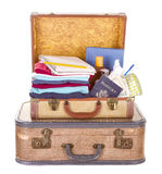 Two vintage suitcases packed. And open showing contents isolated on white Stock Image