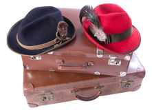 Two vintage suitcases with traditional Bavarian hats. Two vintage suitcases with tradition Bavarian hats over white Stock Photography