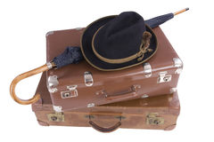 Two vintage suitcases with umbrella and hat. Over white Royalty Free Stock Images
