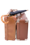 Two vintage suitcases with umbrella. Over white Stock Images