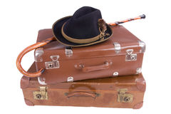 Two vintage suitcases with walking stick and hat. Over white background Royalty Free Stock Image