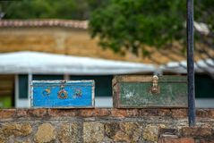 Two vintage suitcases on a wall royalty free stock images