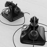 Two vintage telephones Stock Photos