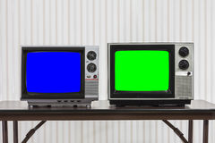 Two Vintage Televisons with Chroma Key Blue and Green Screens. Two vintage televisions with chroma key blue and green screens Royalty Free Stock Photography