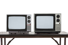Two Vintage Televisons Isolated on White Royalty Free Stock Images