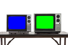 Two Vintage Televisons on Table Isolated with Chroma Screens Royalty Free Stock Image