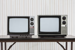 Two Vintage Televisons on Table Royalty Free Stock Photo