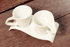 Two Vintage White Cups on Grungy Wooden Table. royalty free stock photos
