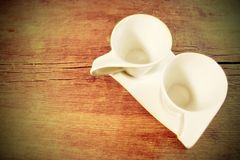 Two Vintage White Cups on Grungy Wooden Table. XXXL stock image