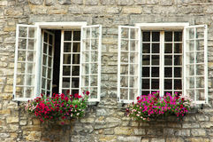 Two vintage windows. Nice open vintage windows with flower boxes open in old Montreal, Quebec, Canada Royalty Free Stock Image