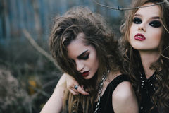 Two vintage witches gathered eve of Halloween Stock Photography