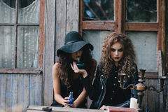 Two vintage witches perform magic ritual Stock Image