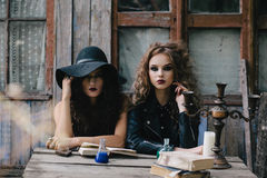 Two vintage witches perform magic ritual Royalty Free Stock Image