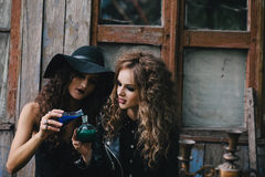 Two vintage witches perform magic ritual Stock Photo