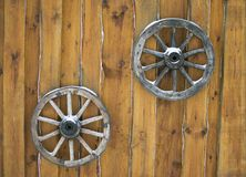 Two  wooden wagon wheel hanging on the wall Stock Images