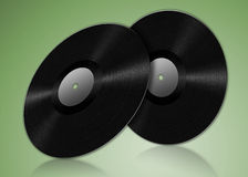Two vinyl records. In a green environment with a reflective surface Stock Photo