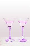Two violet glasses with ribbon. On a tablecloth Stock Photography