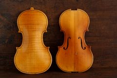 Two violin decks top and back on brown antique wood background stock images