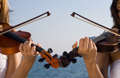 Two violin player Royalty Free Stock Images