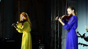 Two violinists play music on stage stock video footage