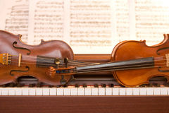 Two violins on piano keys Royalty Free Stock Image