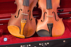 Two violins resting in case. Two violins resting in instrument case Stock Photos