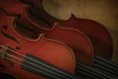 Two violins and a viola. In a diagonal arrangement royalty free stock images