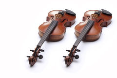 Two violins on white background Royalty Free Stock Images