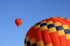 Two vivid red hot air balloons Stock Photo